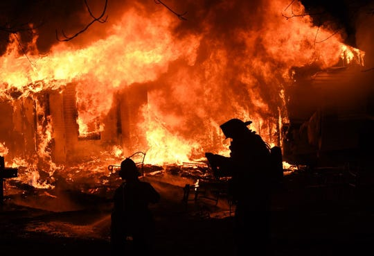 Firefighters battle a blaze that destroyed a Franklin Twp. house on Nov. 12, 2018. (Photo by Curt Werner)