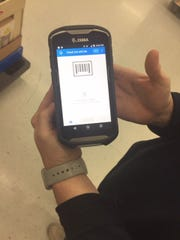 """Walmart has started using a """"Check Out with Me"""" gadget that allows customers to checkout anywhere in the store using a debit or credit card and Walmart Pay."""