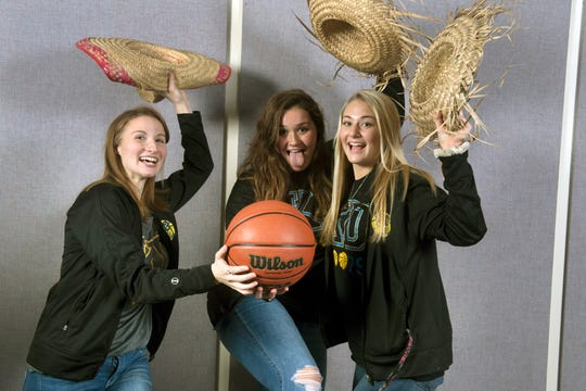 From the left, Megan Thomas, Lily Dressel, and Megan Halczuk, with the Kennard-Dale girls basketball team, pose during the 2018-19 GameTimePa YAIAA Winter Media Day Sunday November 11, 2018.