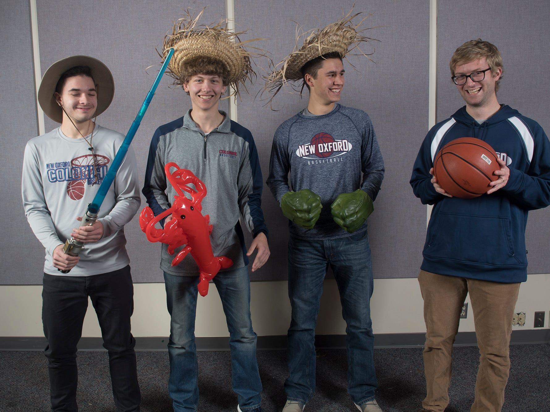 Cameron Krebs, Jaren Rex, Justin Gruver and Sean Bair, with the New Oxford Basketball team, pose during the 2018-19 GameTimePa YAIAA Winter Media Day Sunday November 11, 2018.