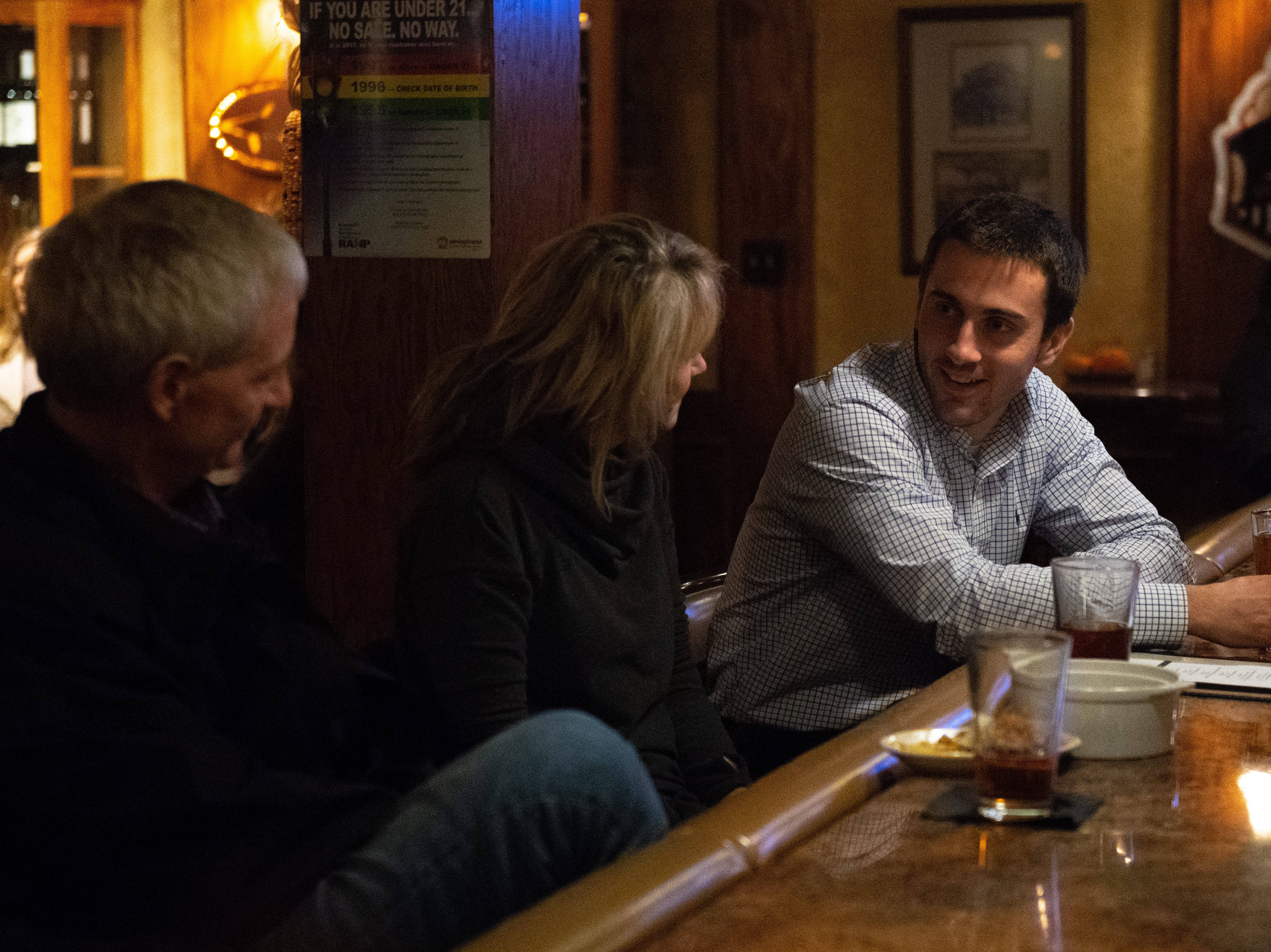 From left, customers Alan, Sandie and John King enjoy drinks and good conversation at the bar.