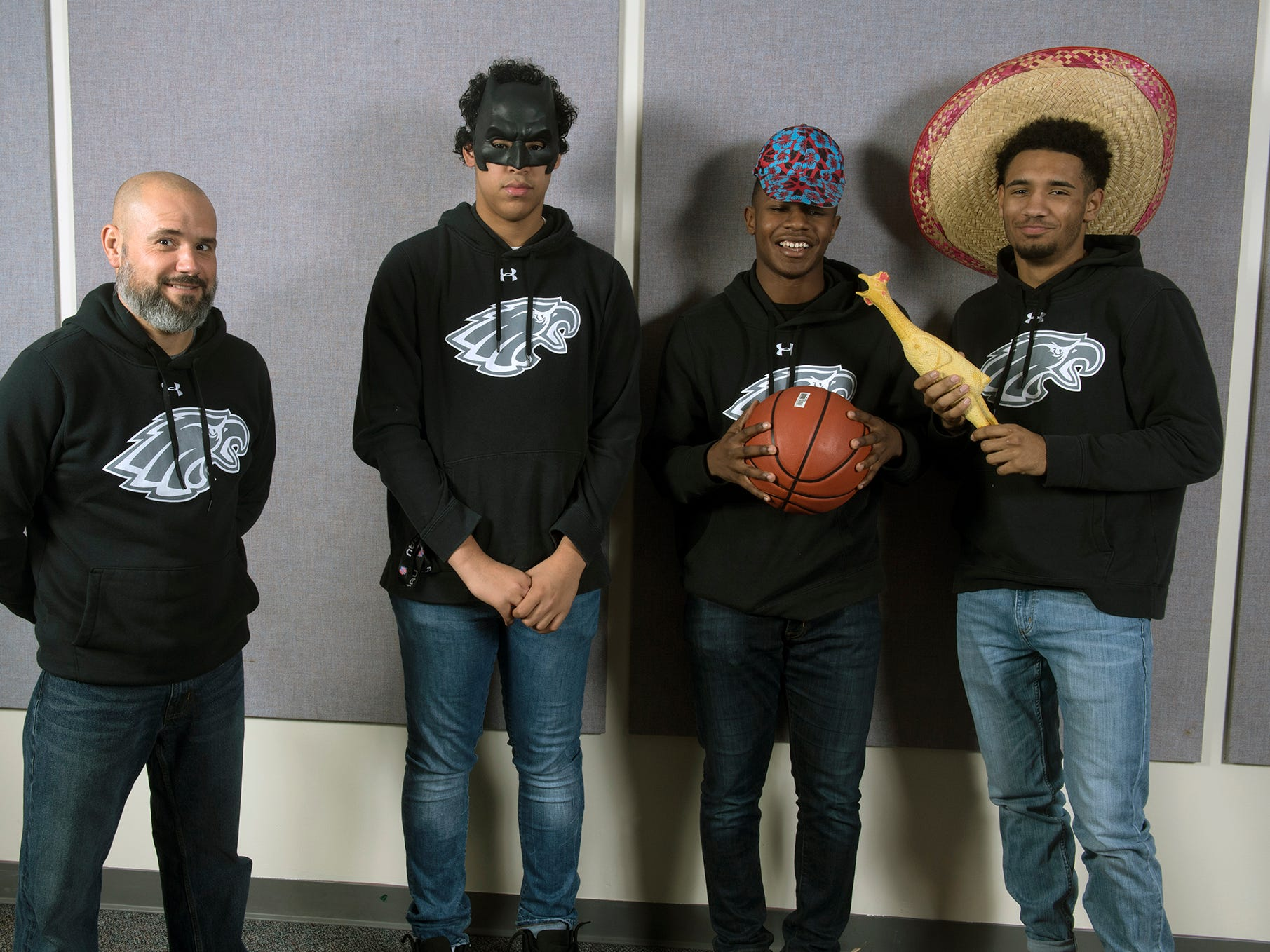 From the left, Coach Brian Schmoyer, Elijah Sutton, Victor Dorm and Keith Davis, of the Dover boys basketball