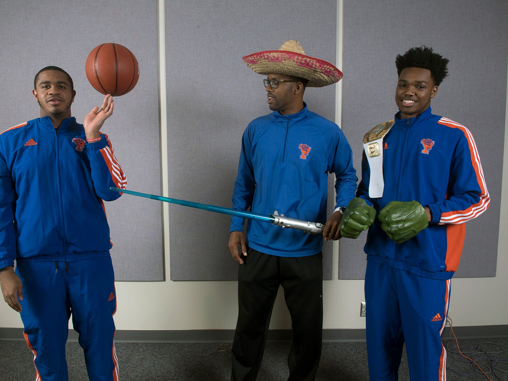 From the left, Marquise McClean, Clovis Gallon and Clovis Gallon Jr., of York High boys basketball team, pose during the 2018-19 GameTimePa YAIAA Winter Media Day Sunday November 11, 2018.