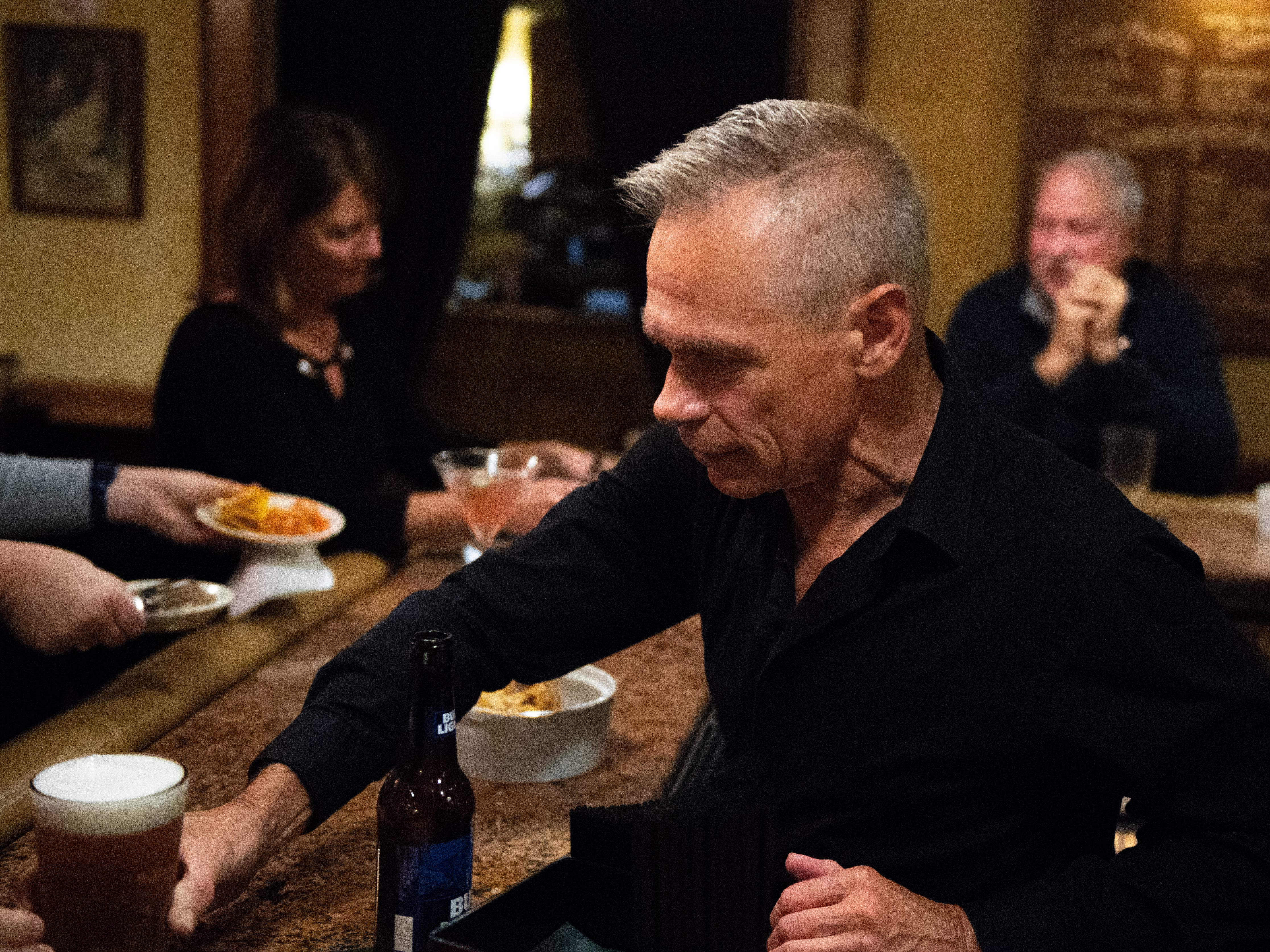 Michael Giuffrida completes the order during happy hour at Roosevelt Tavern, November 9, 2018.