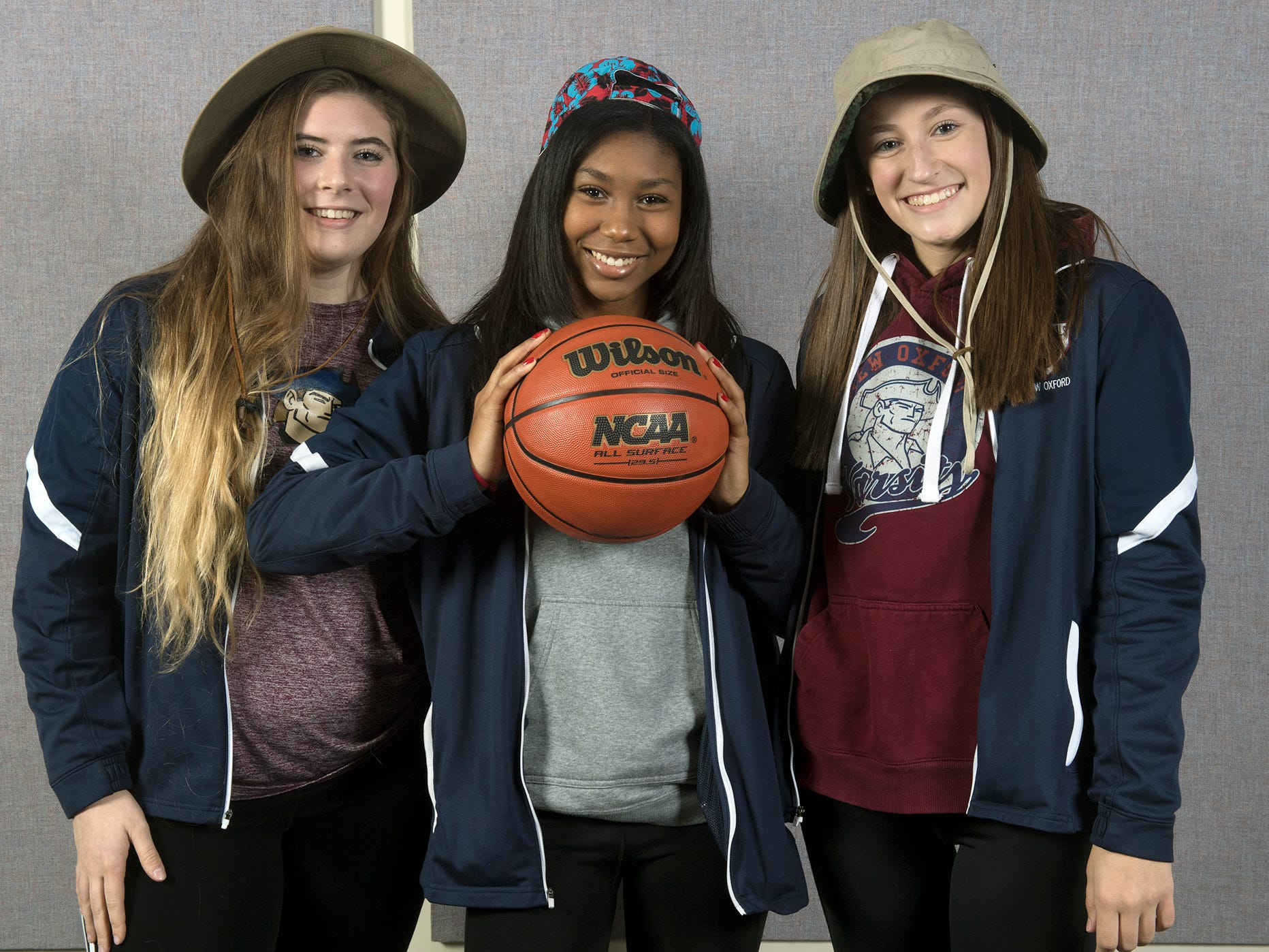 From the left, Natalie Slusser, Jayla Brown, and Maddy Ross, of the New Oxford girls basketball team, pose during the 2018-19 GameTimePa YAIAA Winter Media Day Sunday November 11, 2018.