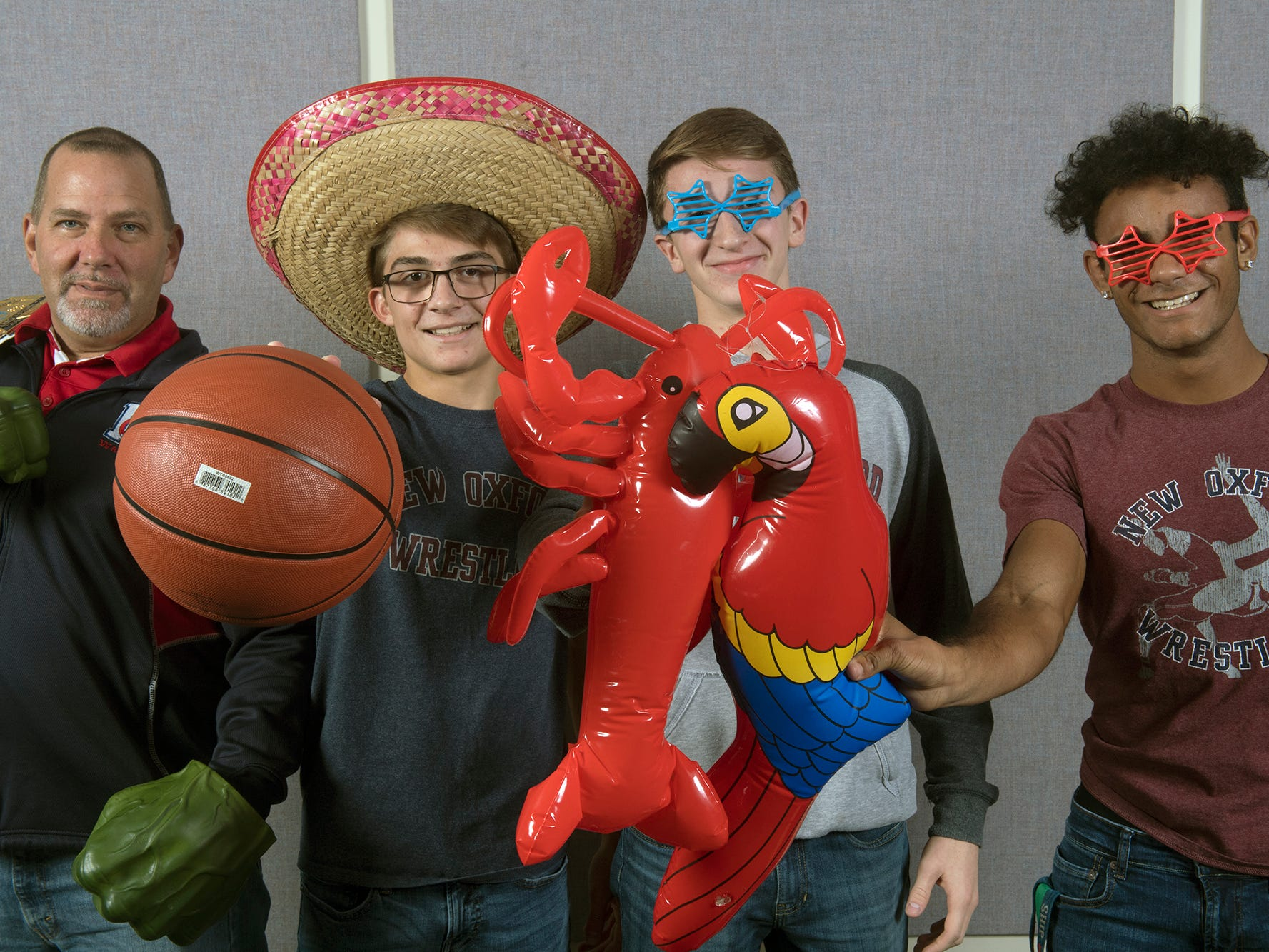 From the left, Coach Brian Martin, Tim Uhler, Jared Bair and J.J. Johnson, of the New Oxford wrestling team, pose during the 2018-19 GameTimePa YAIAA Winter Media Day Sunday November 11, 2018.
