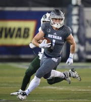 Wolf Pack receiver McLane Mannix picks up yardage against Colorado State earlier this season.