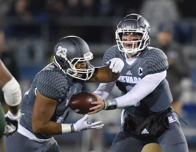 Nevada's Ty Gangi, right, hands off to Kelton More last week against Colorado State.