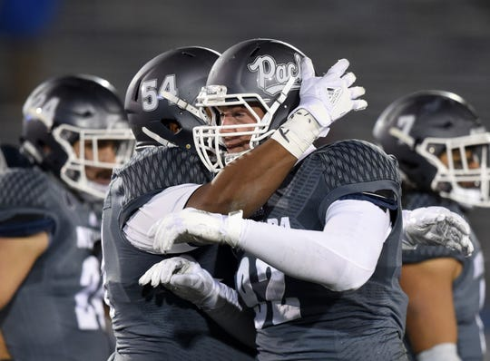 Nevada players celebrate during the Wolf Pack's 49-10 blowout of Colorado State.