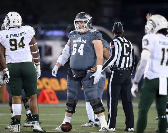 Nevada center Sean Krepsz gets the Wolf Pack offense ready for its next play Saturday against Colorado State.