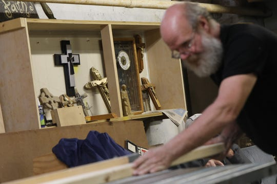 Donald Skillman, one of the founders of Memorials Co-op, cuts rails for caskets.