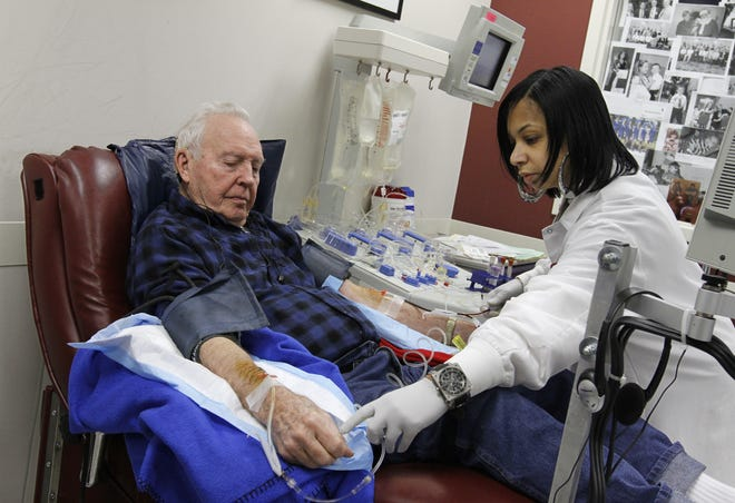 Donor specialist Lavincia Porchea, Rochester, starts the platelets flowing as Vern Thayer, 94, Irondequoit, gives his 381st donation at the American Red Cross Greece Blood Donation Center at 2590 West Ridge Road in Greece on  Nov. 22, 2011.  Thayer earned the title of the Oldest Platelet Donor in the nation.