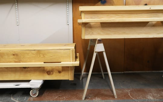 Two of the caskets made and ready for delivery at Memorials Co-op.
