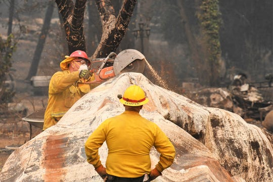 Search and rescue teams were in Paradise, California on Monday, Nov. 12, 2018 to comb through rubble in search of victims of the Camp Fire.