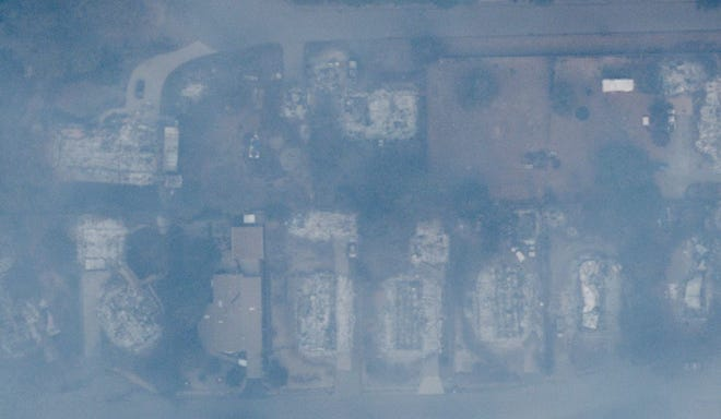 Aerial image made Sunday, Nov. 11, 2018 shows where the Camp Fire burned in Paradise, California. Heavy smoke caused images to appear clouded.
