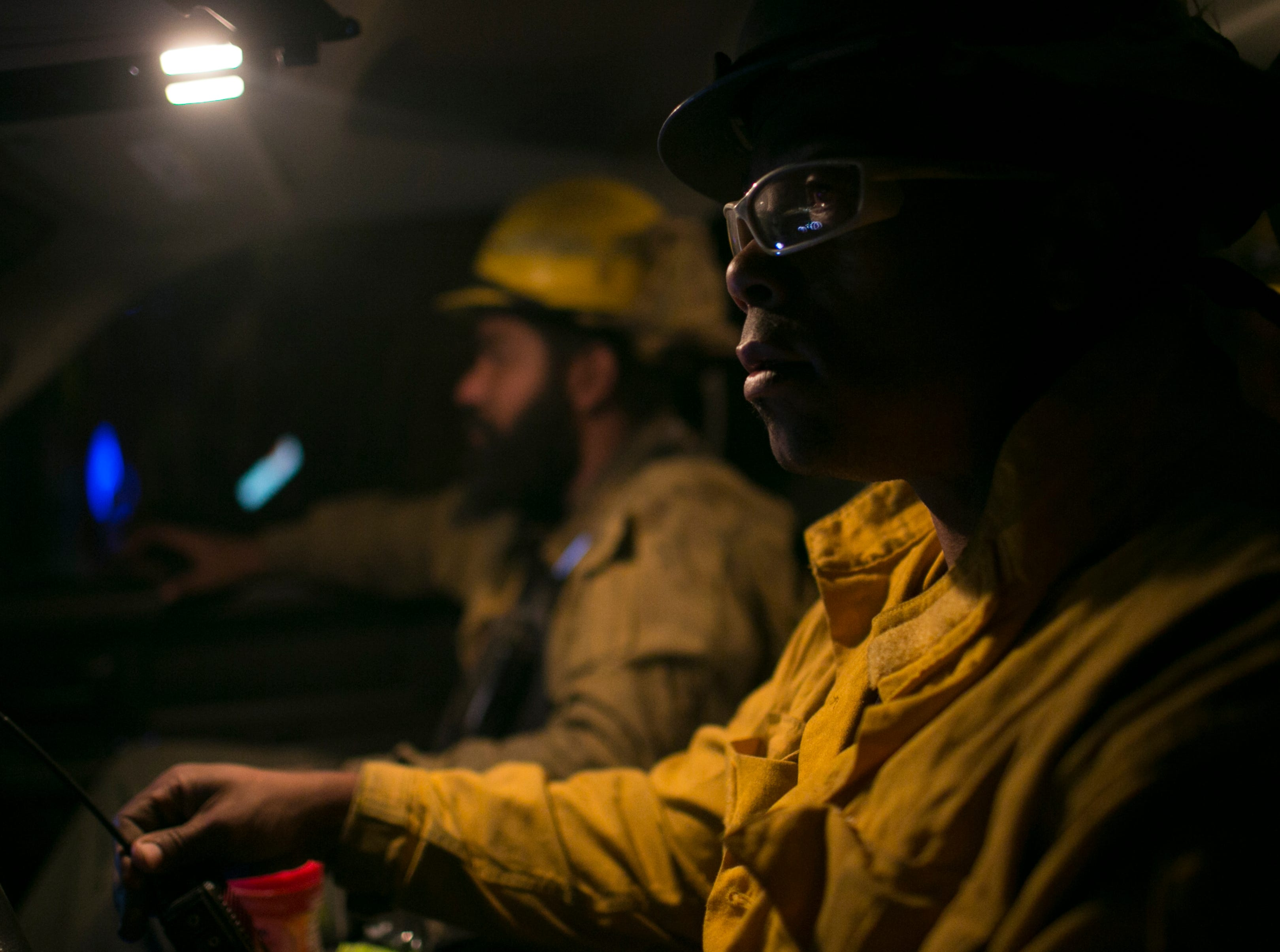 Firefighter Alanzo Smithn(right) sits in a truck waiting to get his next orders to help in fighting the Camp Fire on Nov. 12, in Butte Valley, Calif.
