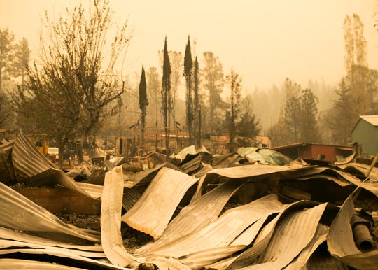 Property destroyed by the Camp Fire lays vacant and burnt on Nov. 12, in Butte Valley, Calif.