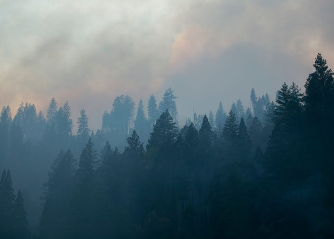Smoke rises from the Camp Fire on Nov. 12, in Butte Valley, Calif.