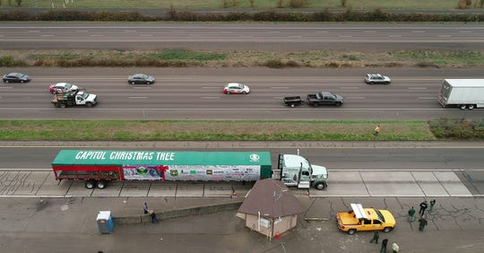 """A truck carrying the U.S. Capitol Christmas Tree pulls into the Oregon Department of Transportation weigh station along Interstate 5 in Woodburn, Oregon, Tuesday afternoon, November 13, 2018. The tree left the Oregon State Capitol in Salem and was on the way to its next stop in Oregon City as the """"People's Tree"""" embarks on a cross-country journey from Oregon to Washington D.C."""
