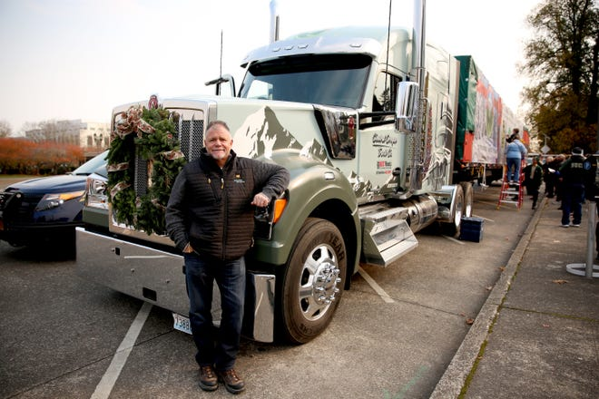 Rick Williams, CEO of Central Oregon Truck Co. and one of the three drivers set for the journey to the U.S. Capitol, poses in front of the truck on Tuesday, Nov. 13, 2018, at the Oregon State Capitol.