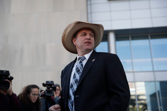 File - In this Dec. 20, 2017 file photo, Ammon Bundy walks out of a federal courthouse in Las Vegas. It's been nearly three years since Bundy, 43, led a group of protesters to occupy the Malheur National Wildlife Refuge, first in protest of the government's treatment of a fellow ranching family, then in protest of federal land ownership. Bundy said his priority now is spending time with his wife and six children. But remnants of the standoffs still bubble up each day. (AP Photo/John Locher, File)