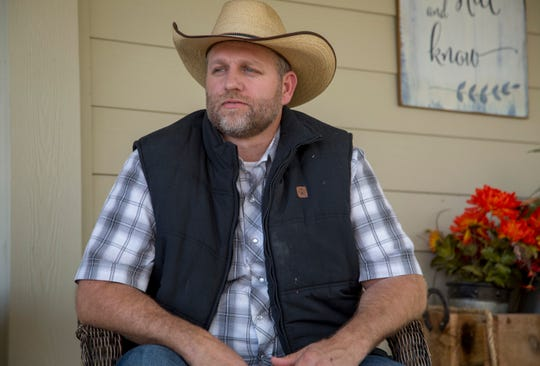 "In this Oct. 24, 2018, photo, Ammon Bundy poses for a photo in Emmett, Idaho. Bundy calls himself a ""sunlight kind of guy."" Before his family's infamous standoffs near Bunkerville, Nevada, and Burns, Oregon, he was living in the dark, he told the Idaho Statesman . Now he's got a new view on life that he's eager to share, he said, and some Idahoans are eager to listen."