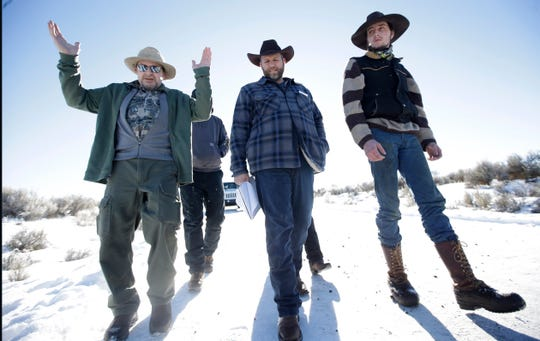 FILE - In this Jan 8, 2016, file photo, Burns resident Steve Atkins, left, talks with Ammon Bundy, center, one of the sons of Nevada rancher Cliven Bundy, following a news conference at Malheur National Wildlife Refuge near Burns, Ore. It's been nearly three years since Bundy, 43, led a group of protesters to occupy the refuge, first in protest of the government's treatment of a fellow ranching family, then in protest of federal land ownership. Bundy said his priority now is spending time with his wife and six children. But remnants of the standoffs still bubble up each day. (AP Photo/Rick Bowmer, file)