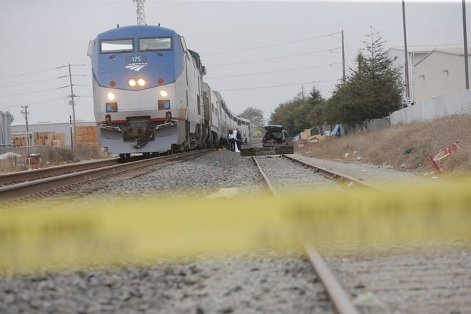 Authorities investigate a fatal crash on railroad tracks Tuesday afternoon.