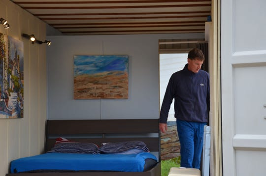 Roger Brul, a Delmarva tiny house entrepreneur, stands in one of the converted shipping units into a small dwellings.