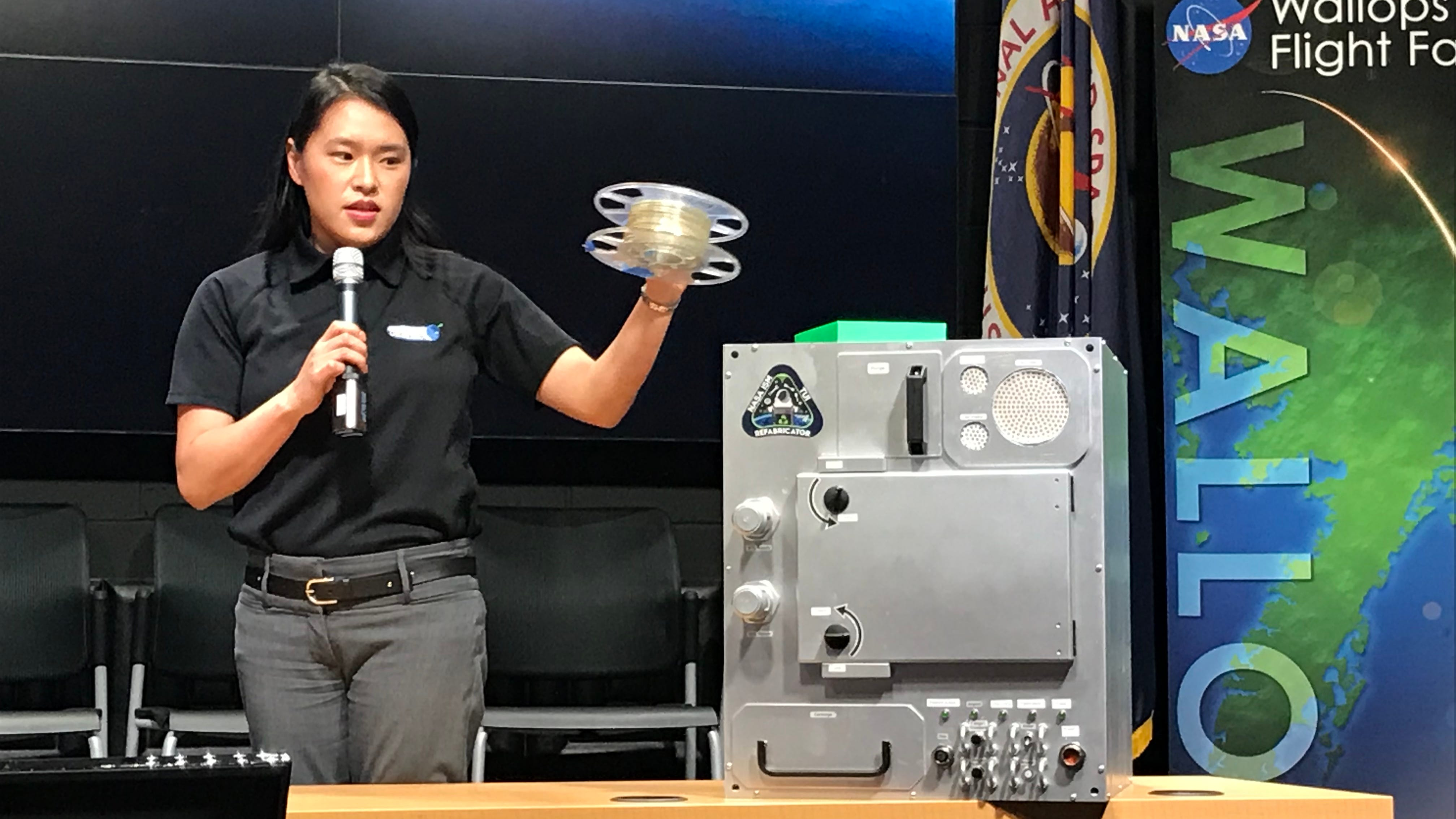 Allison Porter, flight mission manager at Tethers Unlimited, shows some of the technology set to head to the International Space Station.