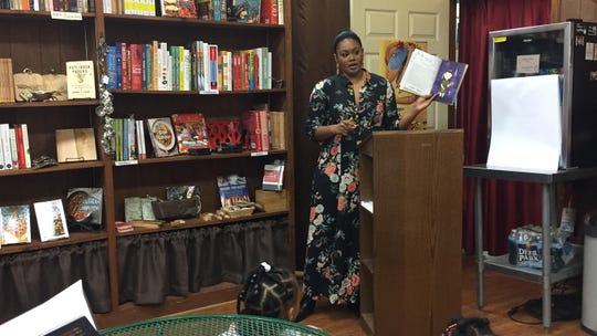 Author and illustrator Vashti Harrison reads from her new book, 'Little Dreamers: Visionary Women around the World,' at the Book Bin in Onley on Wednesday, Nov.7, 2018.