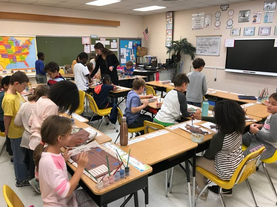 A third grade class at Buckingham Elementary School works on a mural project on Tuesday, Nov. 13, 2018.