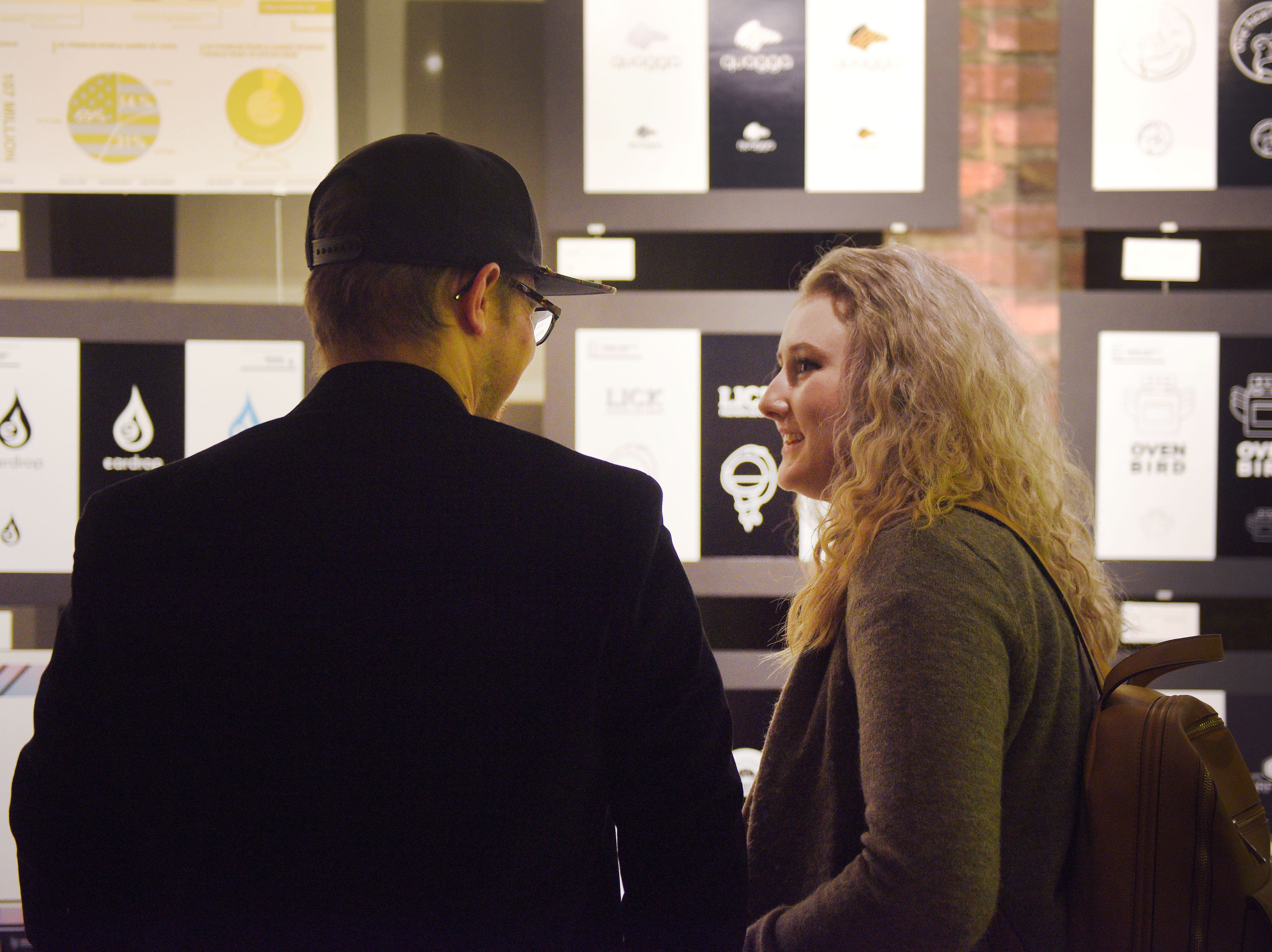 Tyson Schultz and Brianna Olson attend the USD Graphic Design Student work show Wednesday, Nov. 7, at the Sioux Falls Design Center in downtown Sioux Falls.