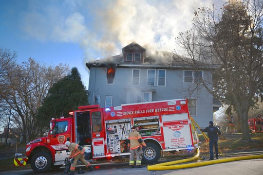 Sioux Falls Fire Rescue puts out a fire at the 300 block of N. Spring Avenue Tuesday, Nov. 13, in Sioux Falls.