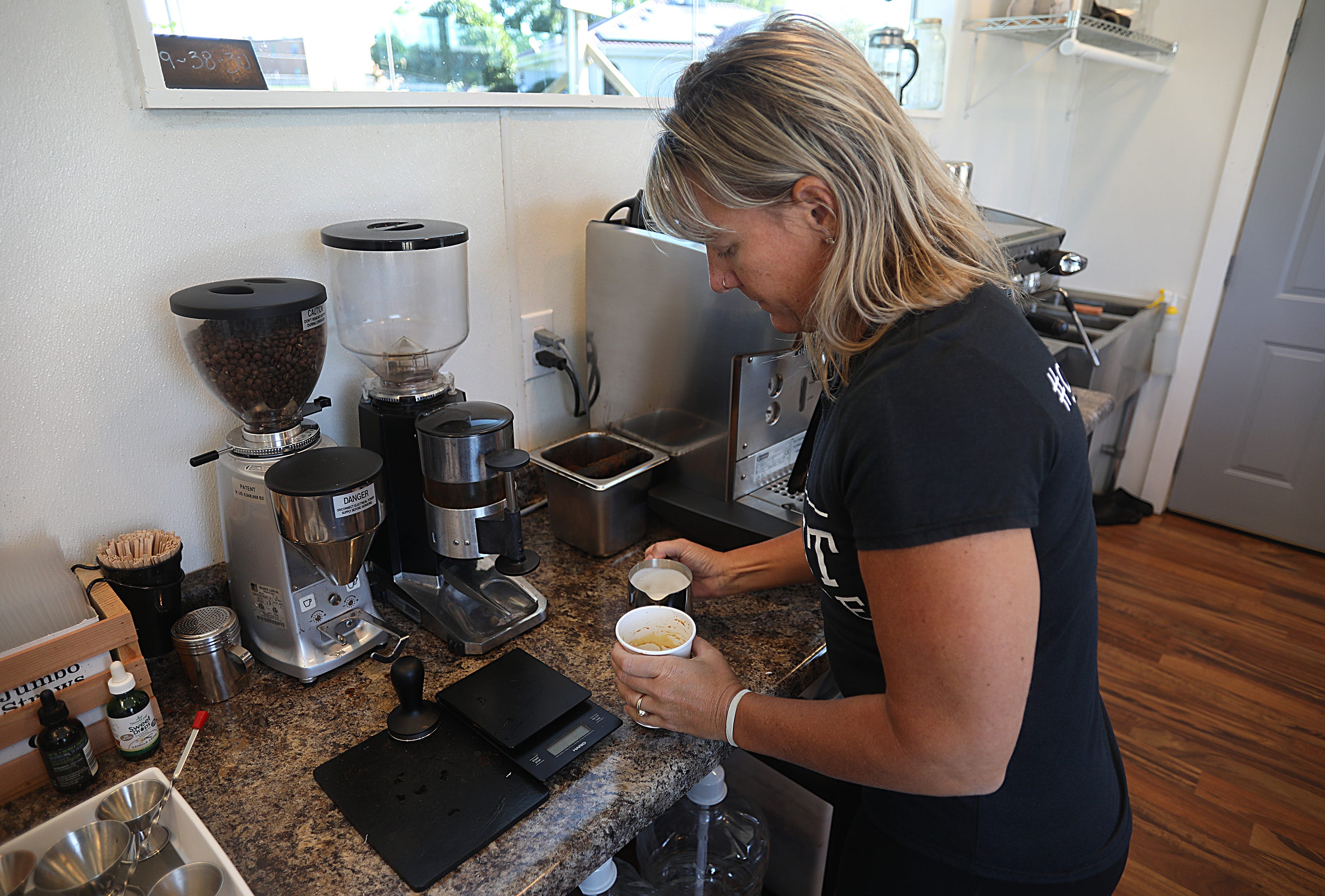 Caroline Bogema and her husband, Jason, bought a tiny house trailer and with the help of their four kids built the coffee shop from the ground up.