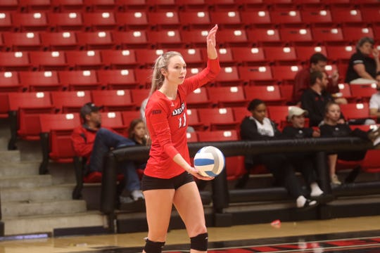 Kendra Sater prepares to serve for Drury University.