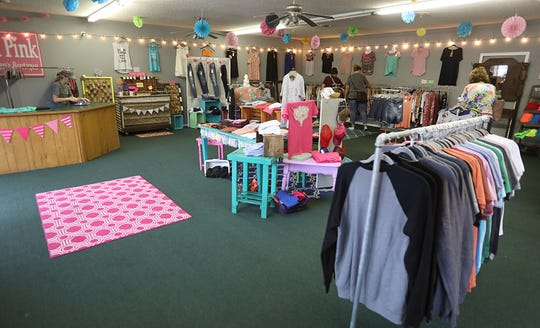 Sarah Holland started her business, Pretty in Pink Boutique, on Facebook in 2012. Four years later, she opened the doors to her first store in Ash Grove and has since moved to a bigger location.
