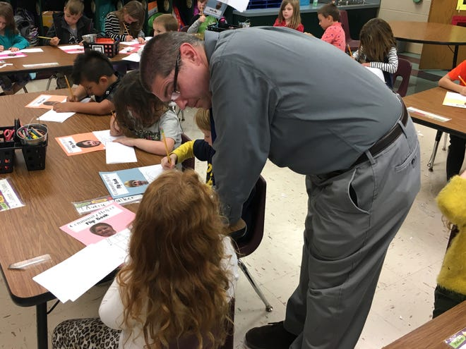 Kris Losh helps a student with her assignment at Guy K. Stump Elementary School in Stuarts Draft.