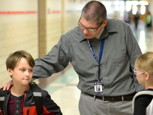 Kris Losh lost his job in radio in August 2017, but he's found a new career, as a reading aide at Guy K. Stump Elementary School in Stuarts Draft.