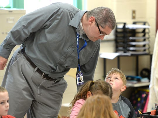 Kris Losh works with kindergarten students at Guy K. Stump Elementary School in Stuarts Draft. Losh is a reading aid at the school.