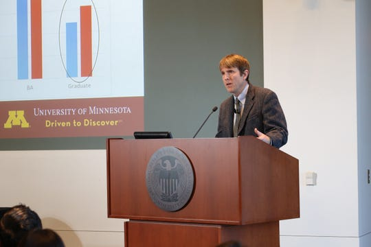 Ryan Allen, University of Minnesota associate professor of community and economic development, talks about immigration and workforce trends in Minnesota on Tuesday, Nov. 13, at the Federal Reserve Bank of Minneapolis during an economics conference.