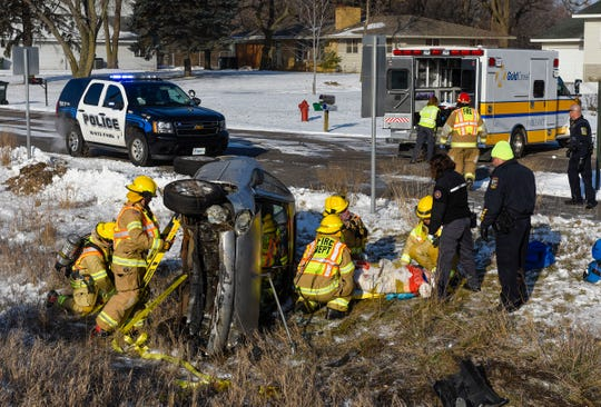 Waite Park firefighters work to free 63-year-old Jamie Koll of Eden Prairie after her vehicle went off Stearns County Road 75 and rolled Tuesday, Nov. 13, near Fleet Farm in Waite Park.