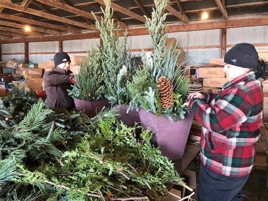 At Hinkemeyer Tree Farm, employees design and prepare fresh pine arrangements in preparation for their opening weekend in 2018.