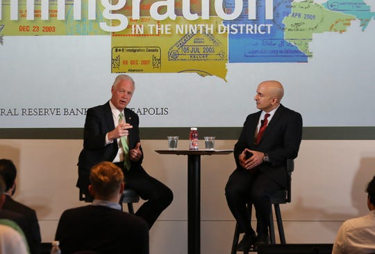 U.S. Sen. Ron Johnson, R-Wisconsin, talks with Neel Kashkari, president of the Federal Reserve Bank of Minneapolis,  in November 2018, about immigration and the workforce during an economics conference in downtown Minneapolis.