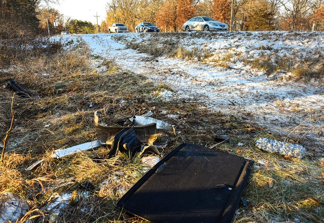 Debris from the stolen Lyft car was left in the ditch where it crashed Tuesday, Nov. 13, along County Road 8 and 38th Avenue.