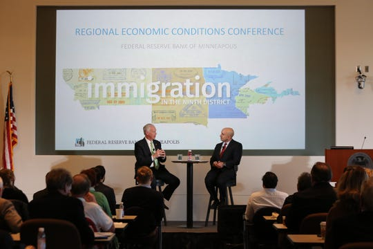U.S. Sen. Ron Johnson, R-Wisconsin, talks with Neel Kashkari, president of the Federal Reserve Bank of Minneapolis, on Tuesday, Nov. 13, during the Federal Reserve's Ninth District Regional Economics Conference in downtown Minneapolis.