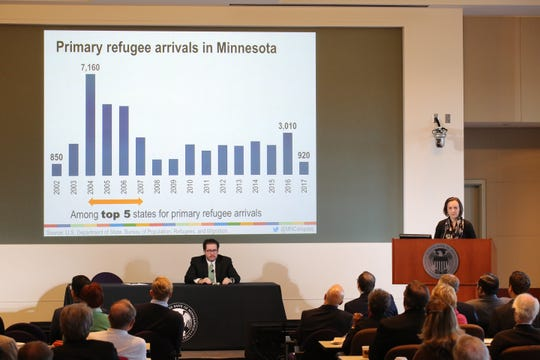 Minnesota Compass' Project Director Allison Liuzzi talks about Minnesota immigration trends at the Federal Reserve Bank of Minneapolis on Tuesday, Nov. 13, during a Regional Economics Conference on workforce and immigration.