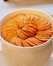 Sliced sweet potatoes ready to make Candied Sweet Potatoes.
