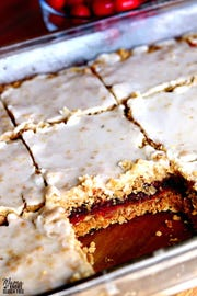 Orange glaze tops cranberry oatmeal bars.