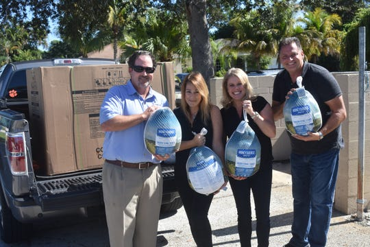 Treasure Coast Legal delivers a freezer full of turkeys to Elev8Hope.